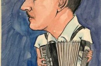 Wray Gibson on stage playing the piano accordian